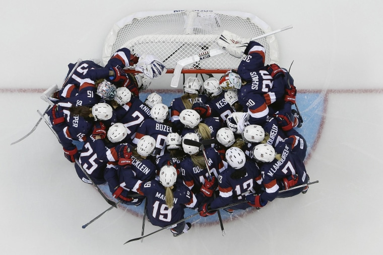 Team USA huddles around the net before the game against Switzerland during the 2014 Winter Olympics women's ice hockey game at Shayba Arena on Feb. 10.