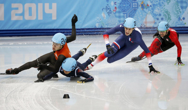South Korea's Park Se-Yeong (2nd L) takes out Sjinkie Knegt of the Netherlands as France's Sebastien Lepape (2nd R) and Canada's Charles Hamelin (R) skate past, during the men's 1,500 metres short track speed skating race finals at the Iceberg Skating Palace during the 2014 Sochi Winter Olympics on Feb. 10.