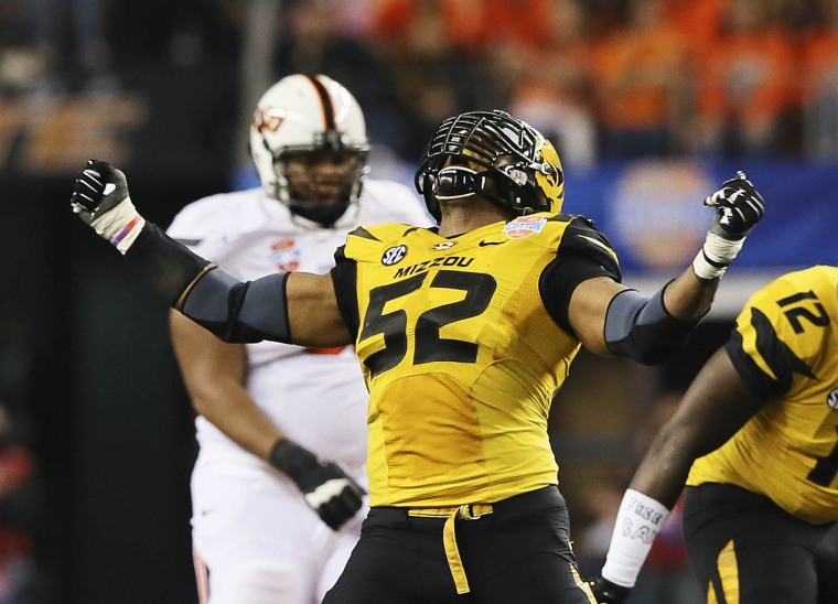 Image: Missouri Tigers defensive lineman Michael Sam (52) reacts after a play during the second half against the Oklahoma State Cowboys in the 2014 Cotton Bowl at AT&T Stadium in Arlington