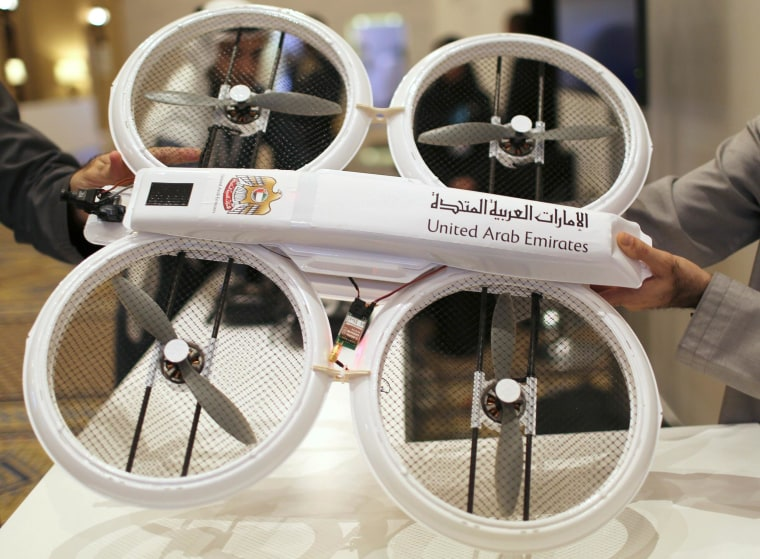 Image: An unmanned aerial drone is displayed during Virtual Future Exhibition, in Dubai