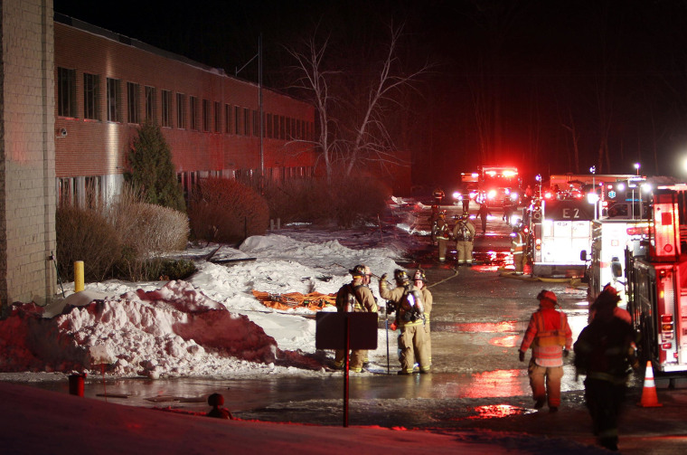 Image: Emergency crews from several towns work an area outside the New Hampshire Ball Bearing plant after an explosion in Peterborough, N.H.