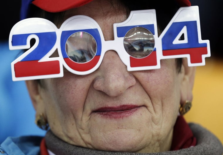 Image: A skating fan wears glasses in the colors of the Russian flag