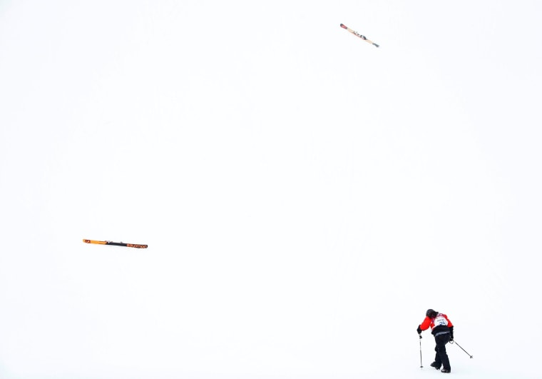 Paraguay's Julia Marino walks towards her skis after crashing during the women's freestyle skiing slopestyle qualification event at the 2014 Sochi Winter Olympic Games in Rosa Khutor February 11, 2014.