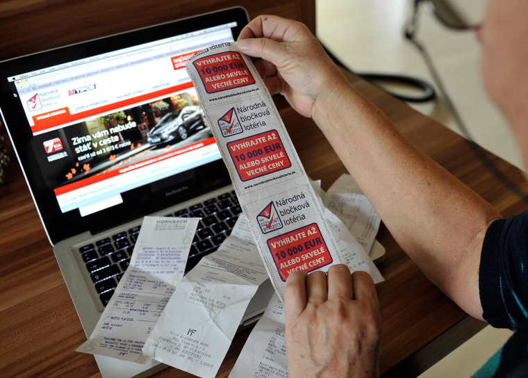 Image: A woman holds store receipts doubling as lottery tickets in Slovakia