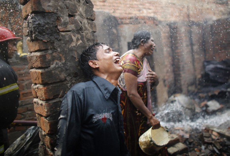 Image: People cry after losing all of their belongings in a fire at a slum at Mirpur in Dhaka