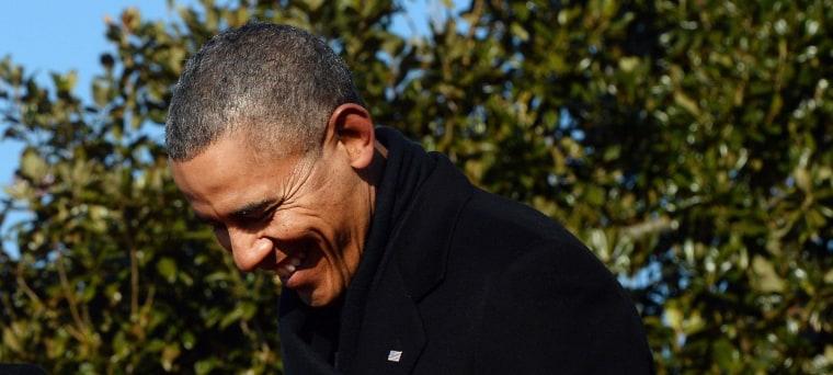 Image: US President Barack Obama smiles as French President Francois Hollande speak