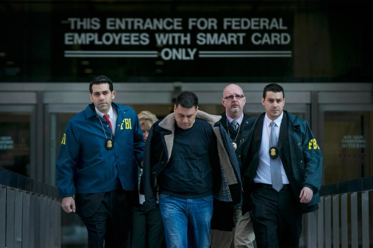 Image: Franco Lupoi, is escorted by FBI agents from their Manhattan offices in New York