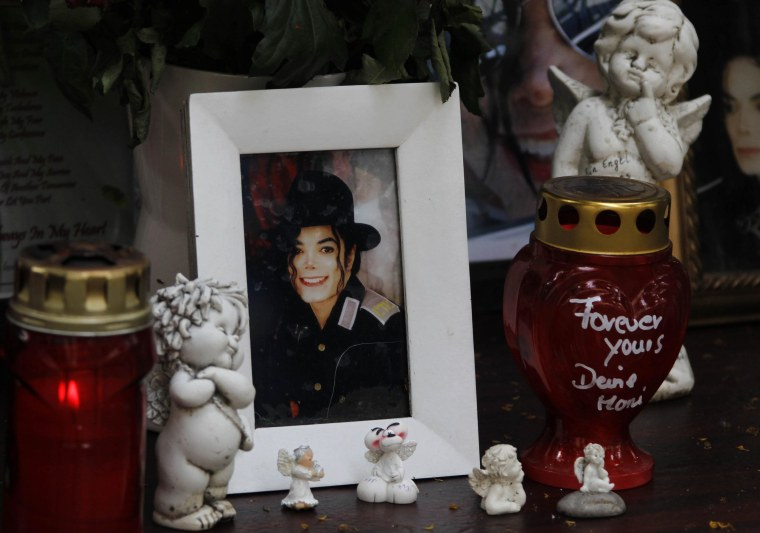 Candles and a picture of the late US pop star Michael Jackson stands at a memorial in Munich, southern Germany, on Thursday, June 24, 2010. The death of Jackson, one year later, continues to captivate the world.