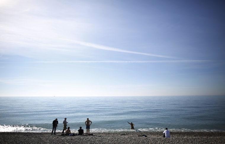 Local residents enjoy bathing along the Black Sea near the Olympic Park in Sochi.
