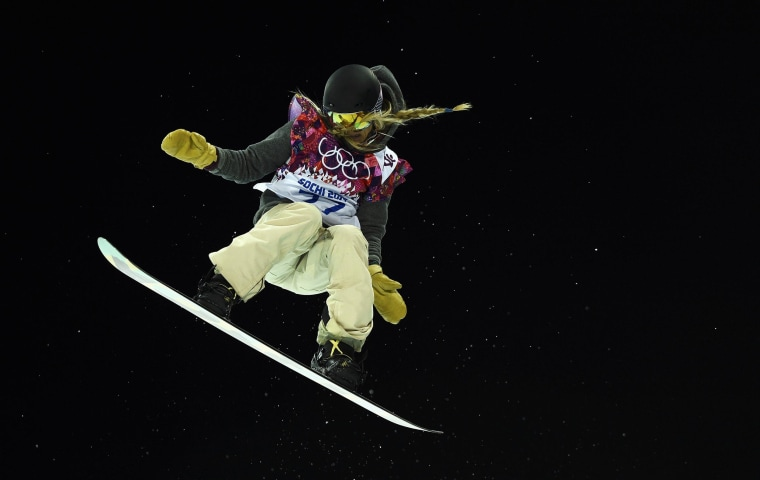 Hannah Teter of the U.S. performs a jump during the women's snowboard halfpipe finals at the 2014 Sochi Winter Olympic Games in Rosa Khutor Feb. 12.