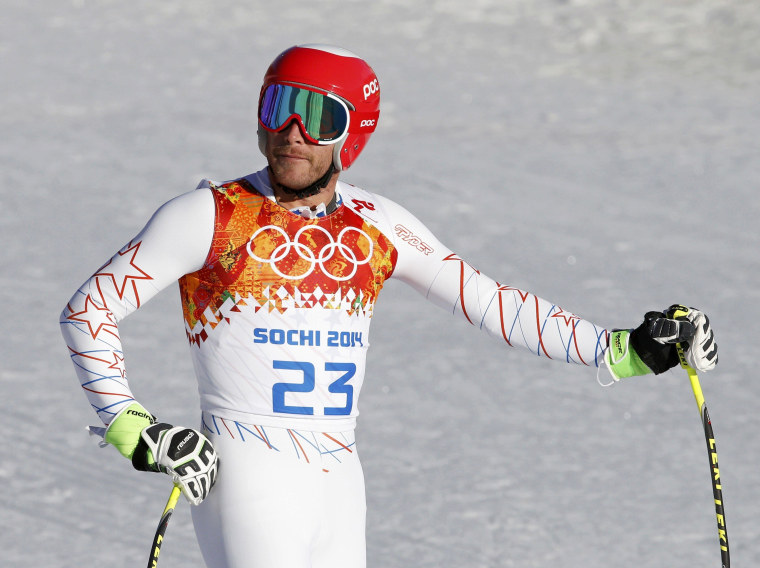 Image: Miller of the U.S. reacts after the downhill run of the men's alpine skiing super combined training session at the 2014 Sochi Winter Olympics