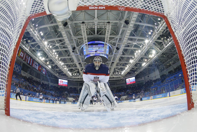 USA goaltender Jonathan Quick looks back into the net before the game against Slovakia during the men's ice hockey tournament at the 2014 Winter Olympics on Feb. 13.