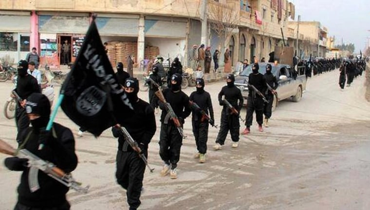 Image: Fighters from the al-Qaida linked Islamic State of Iraq and the Levant (ISIL) marching in Raqqa, Syria