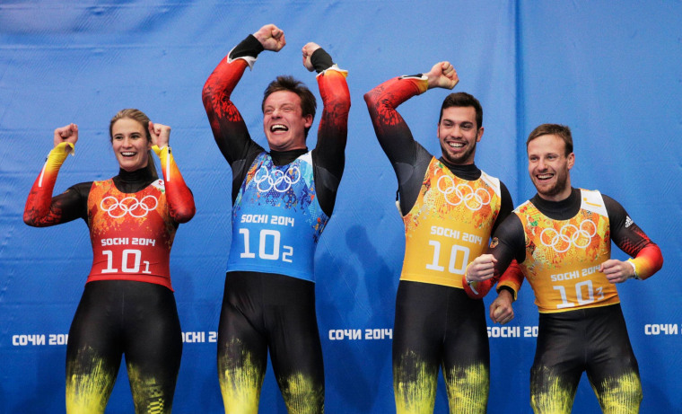 Gold medalists Natalie Geisenberger, Felix Loch, Tobias Wendl and Tobias Arlt (L-R) of Germany celebrate during the flower ceremony for the the Luge Relay on Day 6 of the Sochi 2014 Winter Olympics at Sliding Center Sanki on Feb. 13.