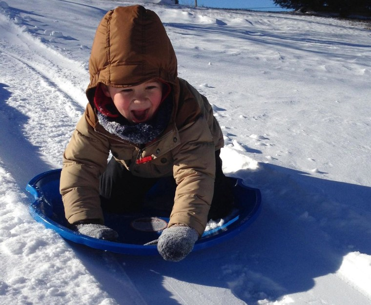 Image: Cristian Shirilla submitted this photo of Landon, 5, as he goes for a downhill speed record during his first sledding trip this year.