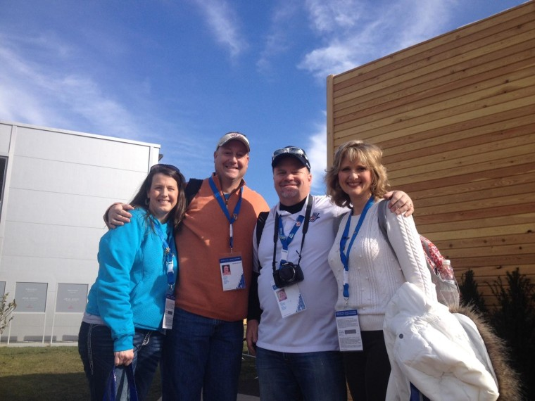 Melanie and Ronnie Draper, along with Greg and Monica Best, all of Oklahoma City, Okla., celebrate Valentine's Day at the Sochi Olympic Park
