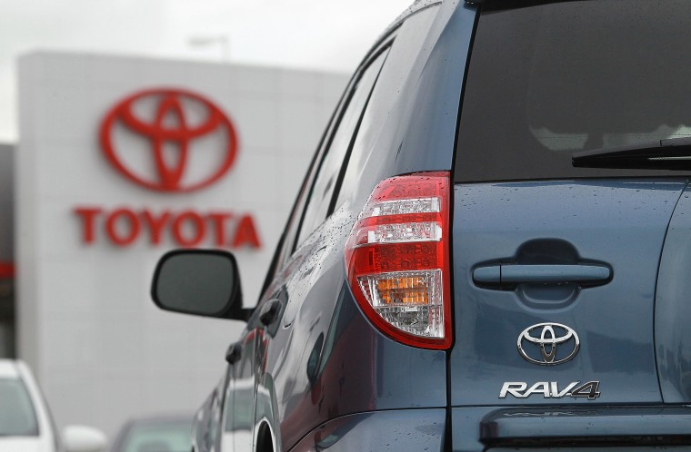 A Toyota RAV4 at a dealership in California. Toyota is recalling more than a quarter million vehicles because of a potential braking problem.