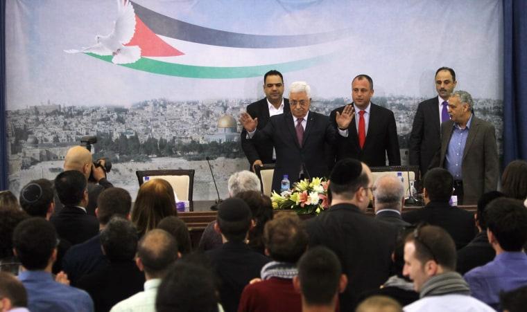 Image: Palestinian President Mahmoud Abbas waves to welcome Israeli University students