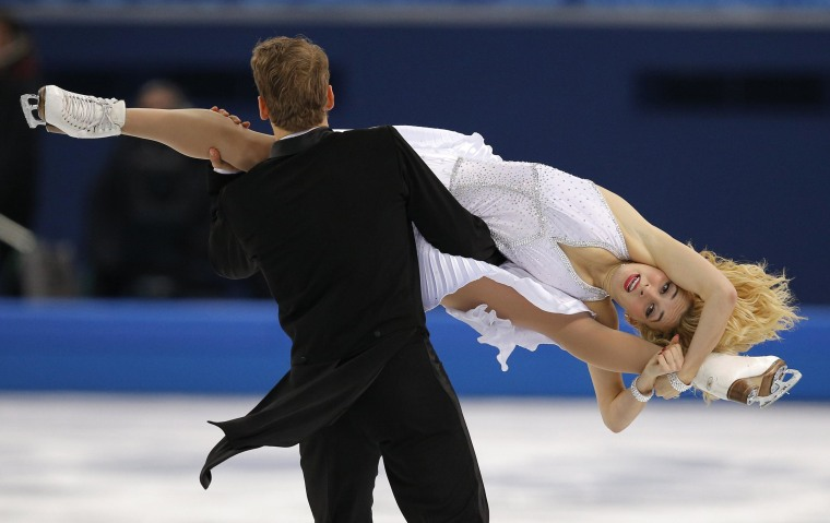 Isabella Tobias and Deividas Stagniunas of Lithuania compete in the ice dance short dance figure skating competition at the Iceberg Skating Palace during the 2014 Winter Olympics, Sunday, Feb. 16, 2014, in Sochi, Russia.