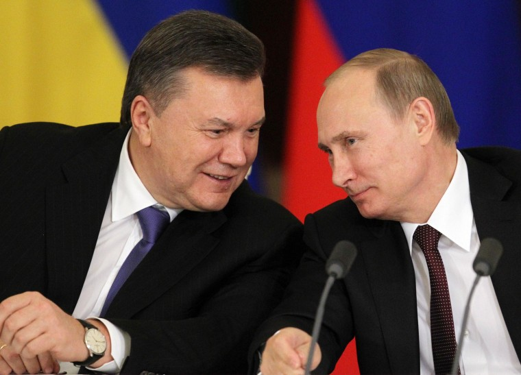 Image: Viktor Yanukovych with Vladimir Putin on Dec. 17