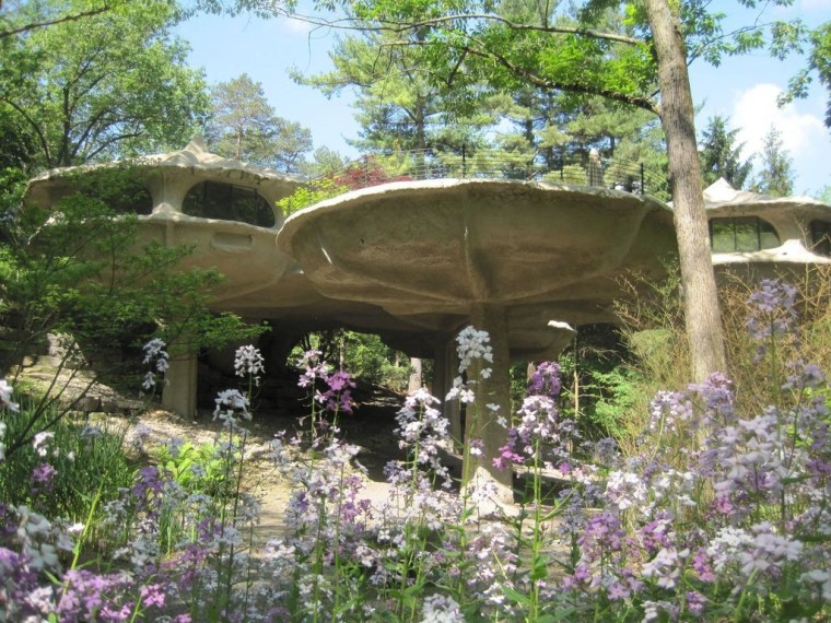 The Mushroom House blends into its New York surroundings in spring.