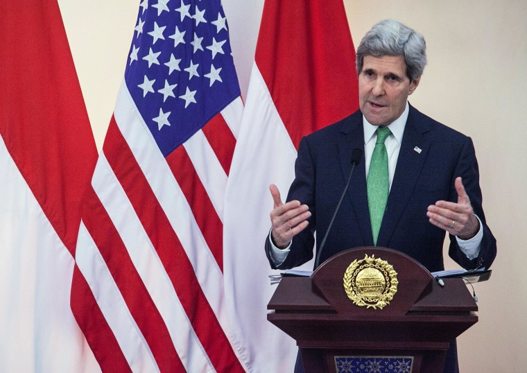 Secretary of State John Kerry gestures during a joint press conference with Indonesian Foreign Minister Marty Natalegawa on February 17, 2014 in Jakarta, Indonesia. Kerry arrived in Indonesia on a visit to highlight concerns over climate change, after agreeing with China to boost joint efforts to fight global warming