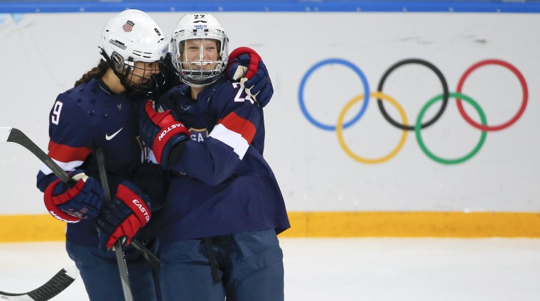 Megan Bozek of the United States, left, congratulates teammate Kacey Bellamy after Bellamy scored a goal against Sweden during the first period of the 2014 Winter Olympics women's semifinal game on Feb. 17.
