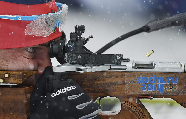 Evgeniy Garanichev of Russia takes a shot during the Men's 15km Mass Start competition during the Sochi 2014 Olympic Games in Krasnaya Polyana, Russia on Feb. 18.