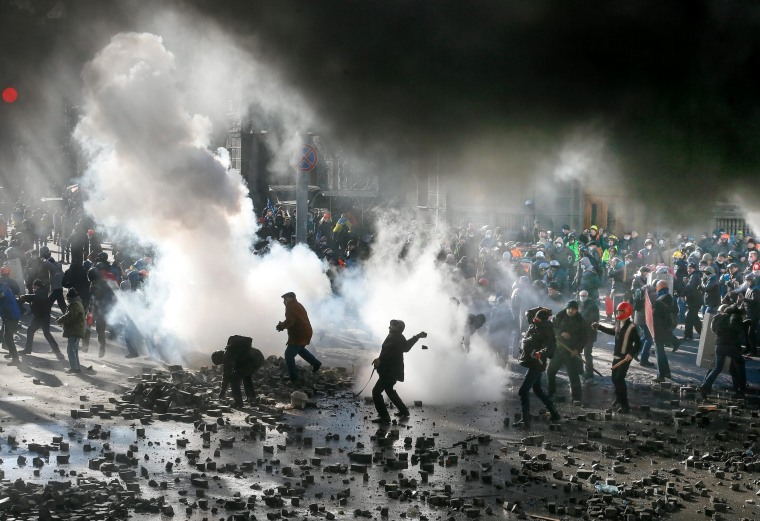 Protesters clash with riot police in downtown Kiev, Ukraine, on Feb. 18. A least three protesters were killed on Tuesday in clashes with police, Ukrainian opposition activists say. Violence erupted in the Ukrainian capital after anti-government protesters broke through a police cordon in front of parliament.