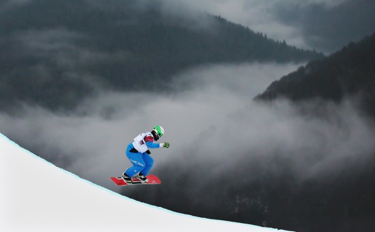 Image: Hanno Douschan of Austria competes in the quarter finals in the Men's Snowboard Cross at Rosa Khutor Extreme Park during the Sochi Olympic Games