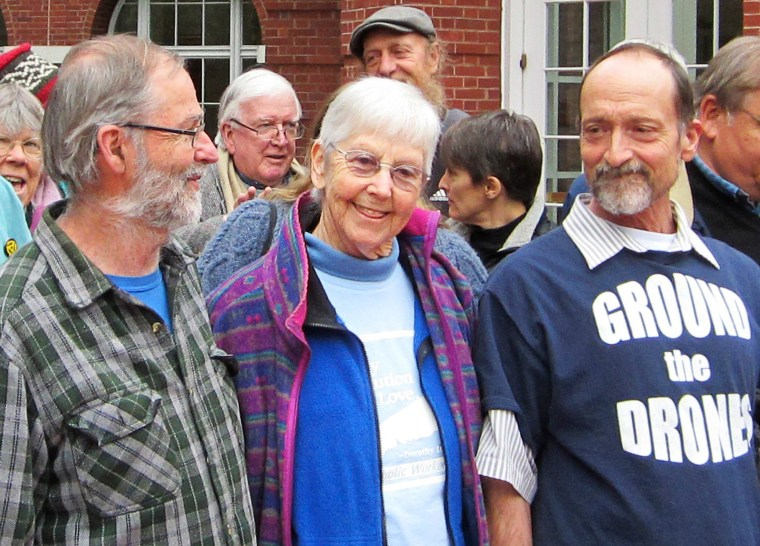 Image: L-R, Greg Boertje-Obed, Sister Megan Rice and Michael Walli are pictured with supporters