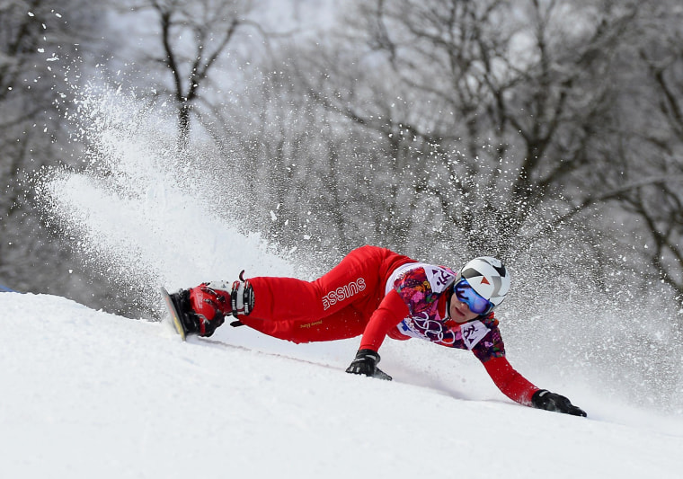 Switzerland's Nevin Galmarini competes in the Men's Snowboard Parallel Giant Slalom elimination run at Rosa Khutor Extreme Park during the Sochi Winter Olympics on Feb. 19.