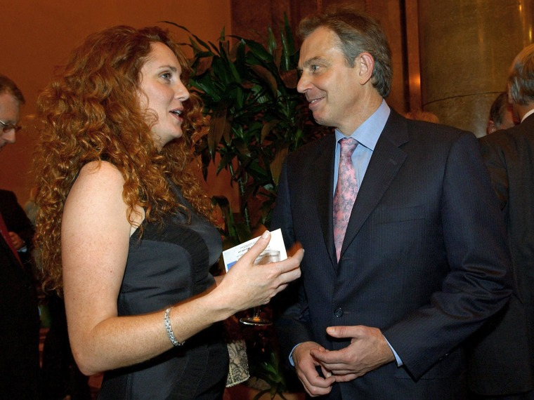 British Prime Minister Tony Blair speaks to Rebekah Wade, now Rebekah Brooks, during the Newspaper Press Fund 40th anniversary reception in central London in 2004.