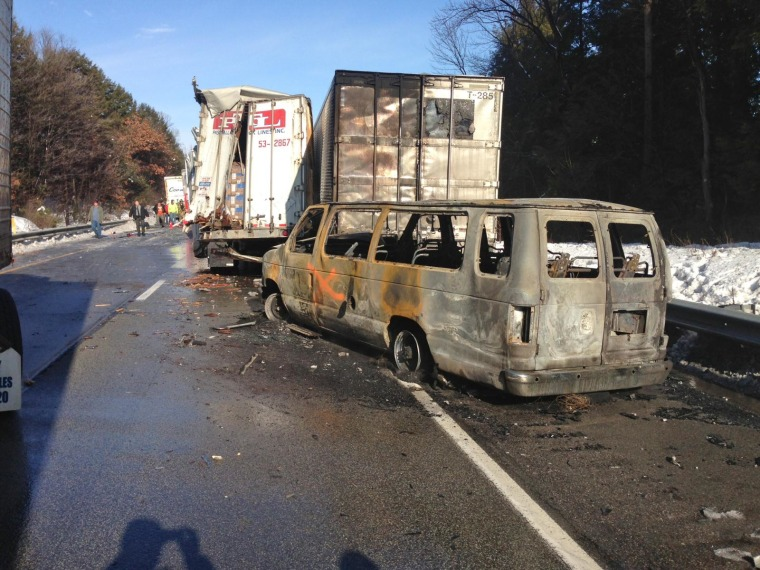 Damaged vehicles line the road after an accident on Interstate 80 in Clearfield Borough, Pa., on Feb. 19, 2014.