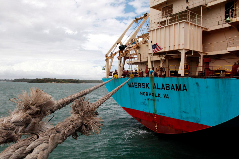 Image: The American flag flies from the aft deck of the of 17,000-ton, Danish-owned Maersk Alabama