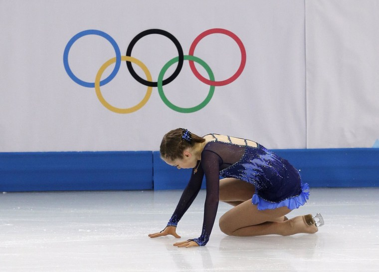 Image: Julia Lipnitskaya of Russia falls when competing in the women's short program figure skating competition