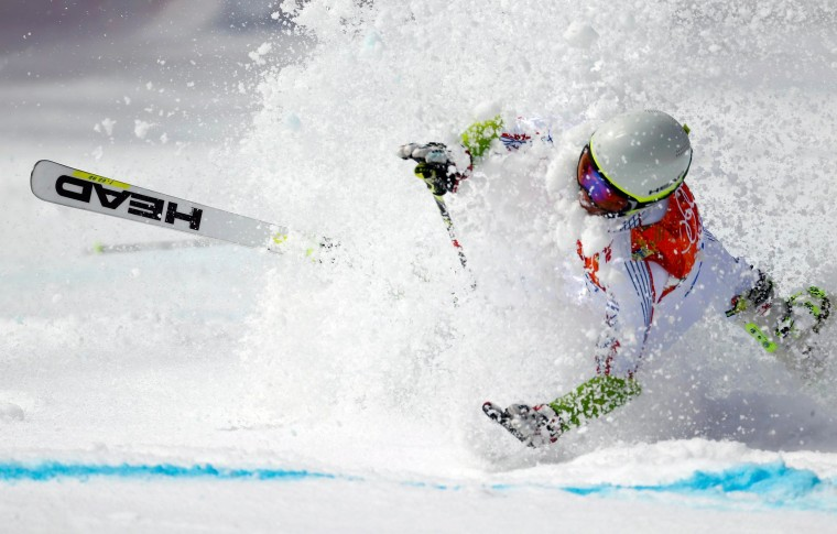 Image: Andorra's Verdu Sanchez crashes during the first run of the men's alpine skiing giant slalom event at the 2014 Sochi Winter Olympics