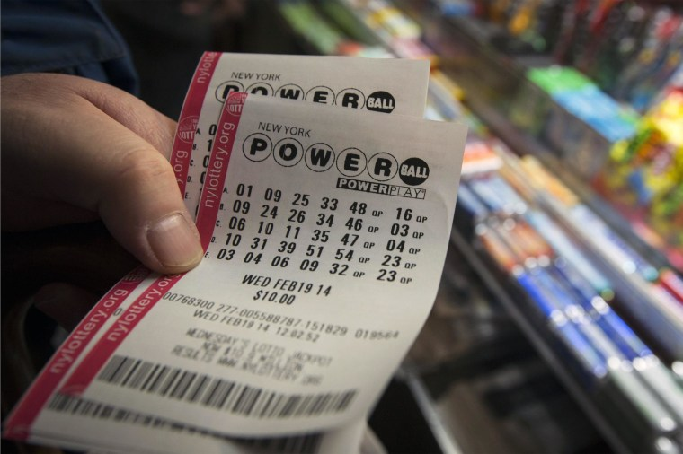 Image: A man purchases New York State Lottery tickets for the $400 million Powerball lottery in New York's financial district