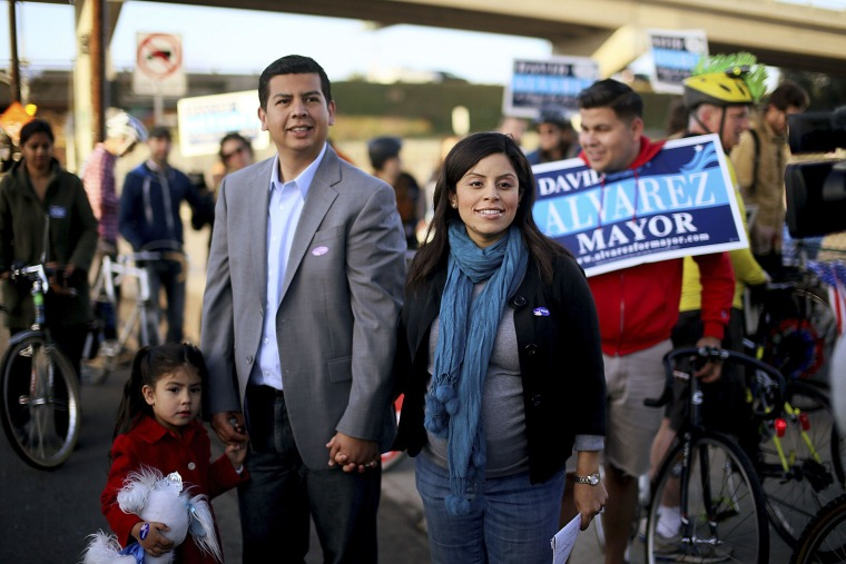 Image: San Diego Democratic mayoral candidate David Alvarez walks with his wife Xochitl and Daughter Izel before voting at Calvary Baptist Church in San Diego