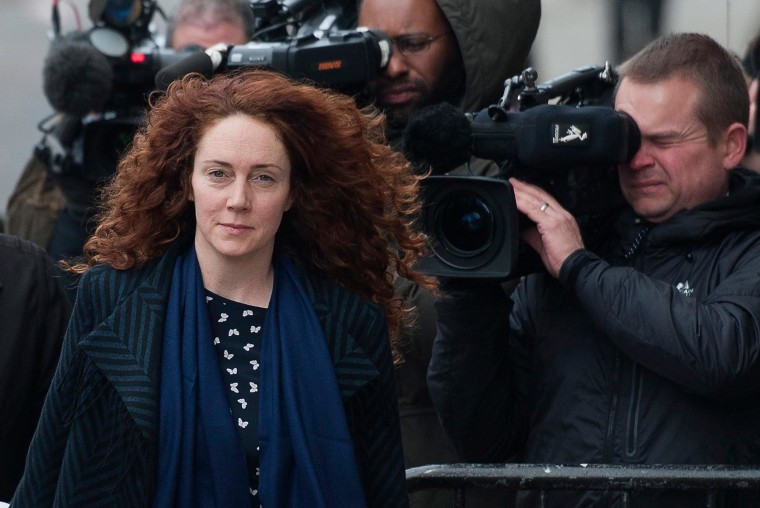 Rebekah Brooks, former chief executive of Rupert Murdoch's British newspapers, arrives at court Wednesday in London for the opening of her defense in the trial of seven people, including the former communications director for Prime Minister David Cameron, in the British phone-hacking scandal.