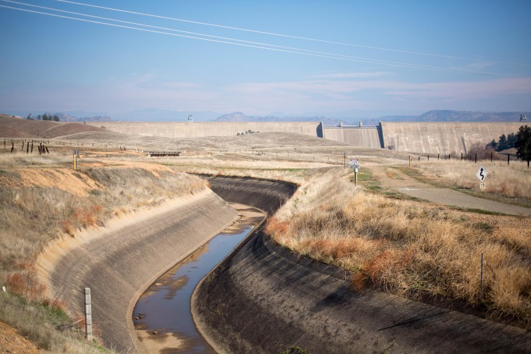 Image: A trace of water sits in the bottom of a canal in California.