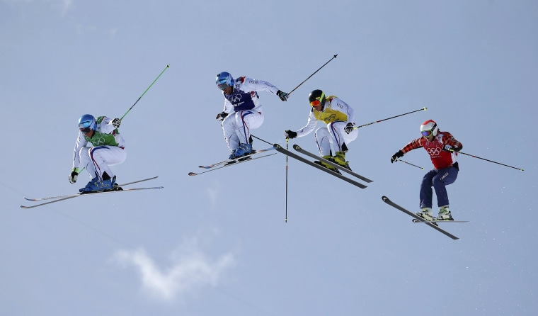 Image: France's Chapuis competes with compatriots Bovolenta and Midol and Canada's Leman during men's freestyle skiing skicross finals round at 2014 Sochi Winter Olympic Games in Rosa Khutor