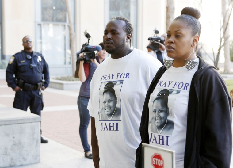 Image: Nailah Winkfield, mother of Jahi McMath, and Martin Winkfield arrive at the U.S. District Courthouse for a settlement conference in Oakland