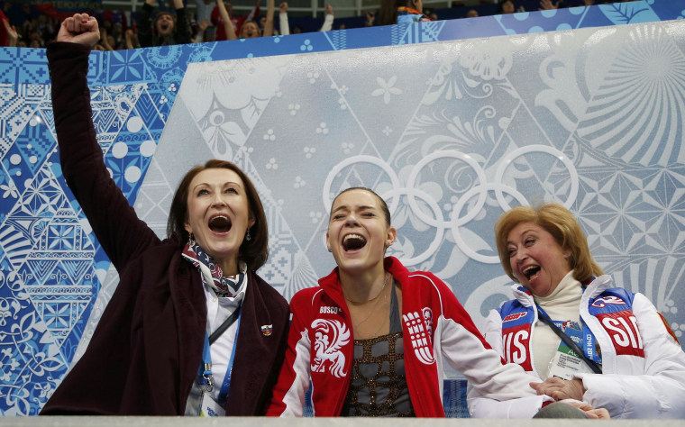 """Image: Russia's Adelina Sotnikova reacts in the """"kiss and cry"""" area during the Figure Skating Women's free skating Program at the Sochi 2014 Winter Olympics"""