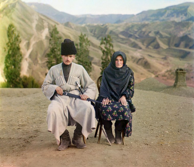 A man and woman pose outdoors in Dagestan, between 1905-1915.