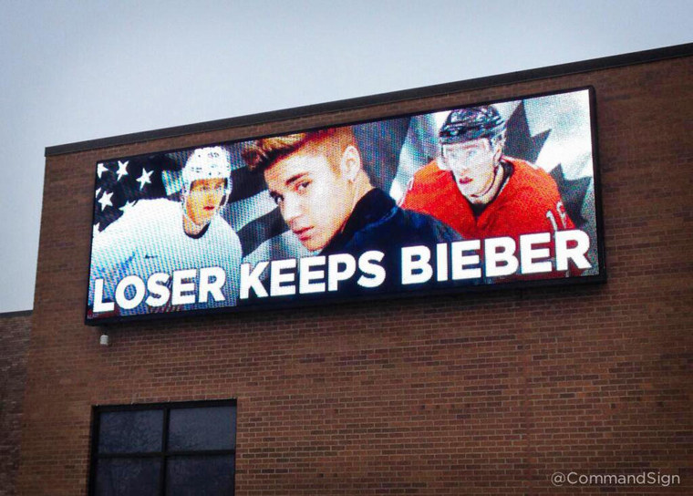 Image: A Command Transportation billboard in Skokie, Ill., proposes, in jest, the loser of the Olympics mens hockey final keeps Justin Bieber.