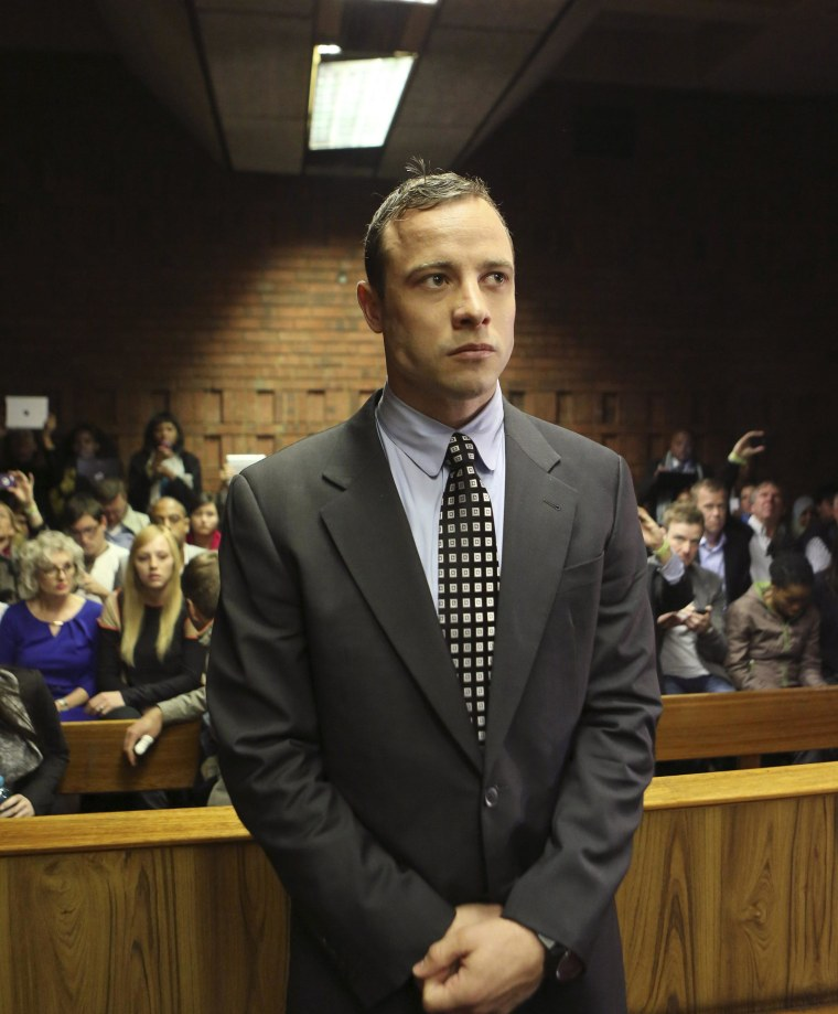 Image: Oscar Pistorius enters the dock before in court proceedings at the Pretoria Magistrates court