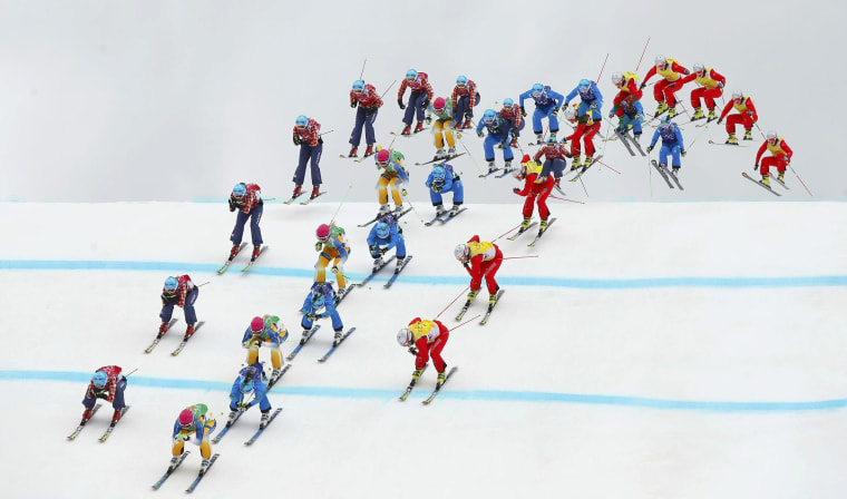 Image: Sweden's Holmlund, Canada's Serwa, Austria's Ofner and Switzerland's Smith competes during women's freestyle skiing skicross semi-finals at 2014 Sochi Winter Olympic Games in Rosa Khutor