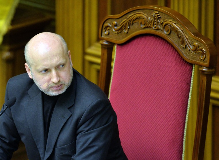 Image: Parliament Speaker and newly-appointed interim president of Ukraine, Olexandr Turchynov attends a session at the Parliament in Kiev