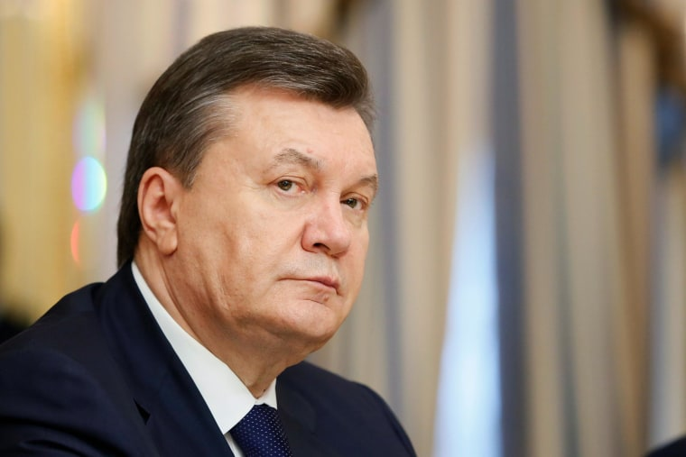 Image: Ukrainian President Viktor Yanukovych before the signing of the Agreement in the Presidential Palace on February 21, 2014 in Kiev,